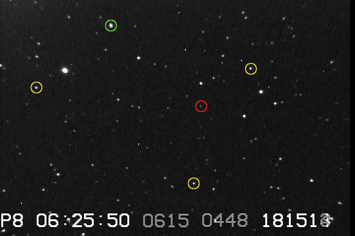Video image of a star field taken by Jerry Bardecker. This image was taken with SENSE-up x128 and a computer-based frame grabber. The red circle is around a 15th magnitude star. The yellow circles are around 13th magnitude stars. The green circle is around an 11th magnitude star. The faintest stars that can be seen here are about 16th magnitude.