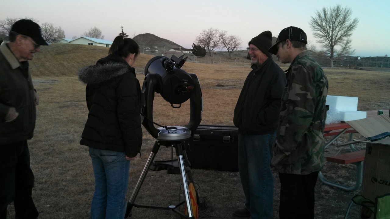 Tonopah team members working with telescope outside